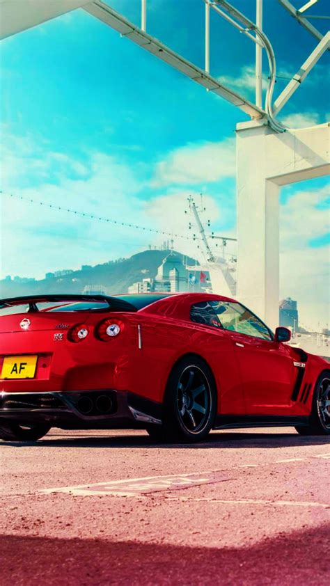 hd background nissan gt  red color rear view sportscar