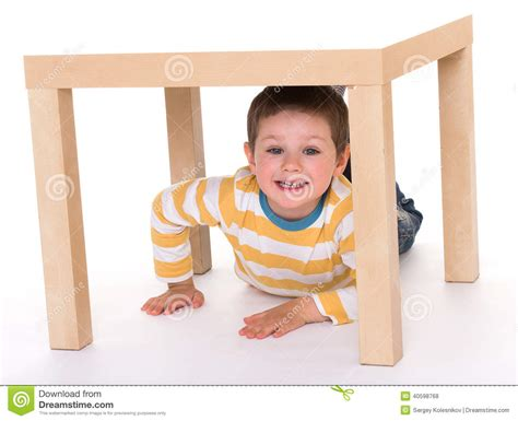 boy is sitting on the table stock photo image