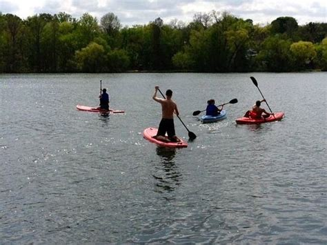 sailboat rental lake george a group of friends enjoying standup paddle boarding and
