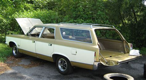 dark green station wagon first station wagon bought in early 1970s ours was two