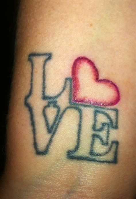 tattoo of love on wrist tattoos designs ideas and meaning tattoos for you