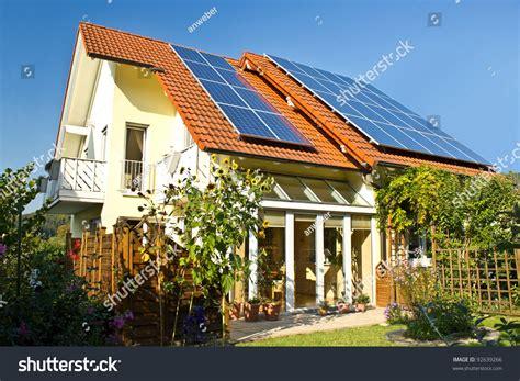 running a house on solar power house garden solar panels on roof stock photo 92639266