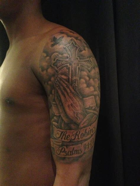 hand tattoo no sleeve black and grey praying hands with cross and banner tattoo