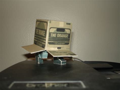 Metal Gear Papercraft - the orange solid snake in a box papercraft gematsu