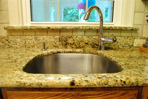 kitchen faucet placement single sink vs sink which is better