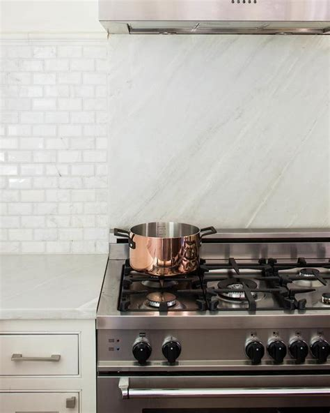 marble slab cooktop backsplash transitional kitchen