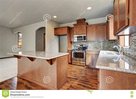 kitchen room interior kitchen room interior with brown cabinets kitchen island granite counter tops stock photo