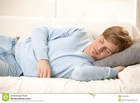 man sleeping on couch young business man posing royalty free stock photography