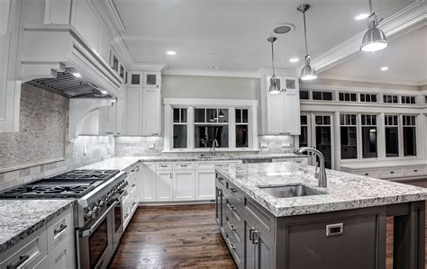 white kitchen with white granite alaska white granite