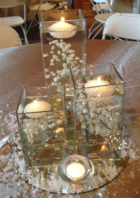 Baby's breath submerged in square vases with floating