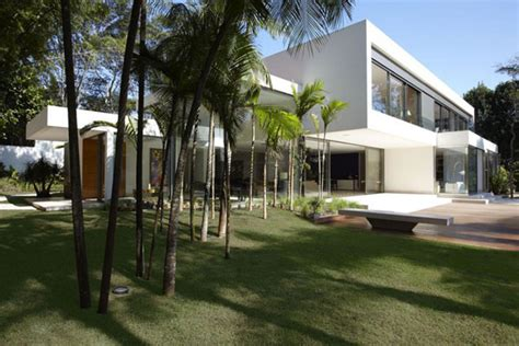 contemporary hillside home in brazil disappears into the landscape energy efficient hillside home in brazil morumbi