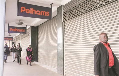 pelham court motors walk past a pelhams branch with closed roller