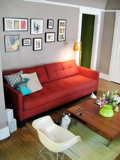 blue walls red couch red sofa grey walls turquoise and apple green accents