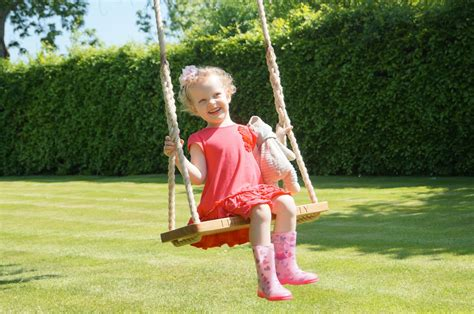 kids on swings wooden garden swings makemesomethingspecial co uk