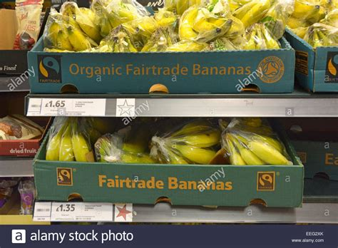 Shelf Of Bananas by Boxes Of Organic And Fairtrade Bananas On Supermarket