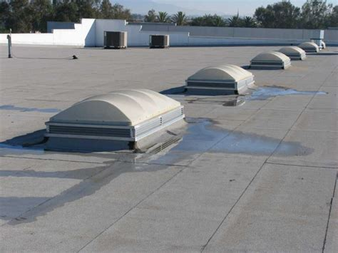 flat commercial roof skylights benefits and drawbacks