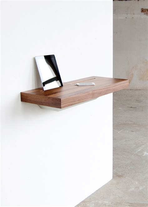 stage interactive wall shelf works as a charging station stage interactive shelf by spell moco loco