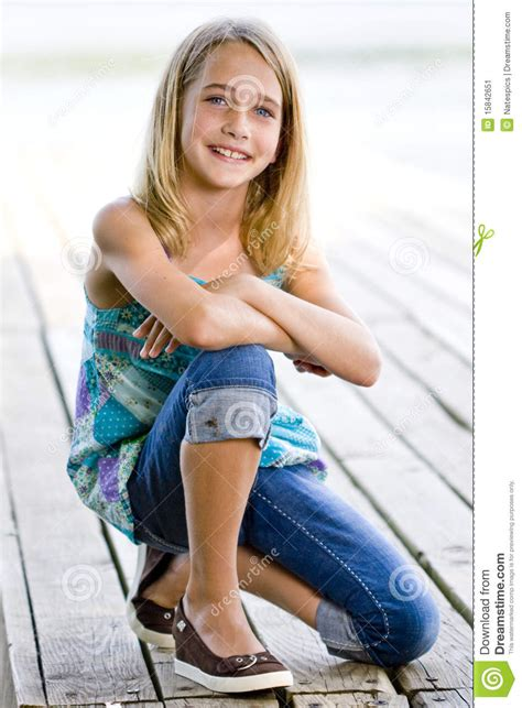 tween teenage girls young tween girl kneeling on a dock stock image image