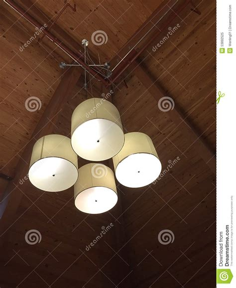 hanging from the ceiling light fixtures hanging at the ceiling stock photo image