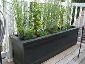 condo balcony planter my boyfriend made me some unique planters for my patio the tall grasses