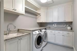 white shaker laundry room cabinets with gray granite