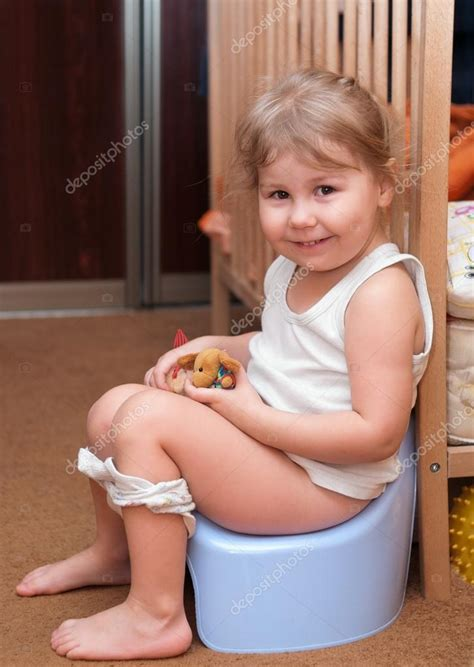 underground very young little girls little girl sitting on a chamber pot stock photo