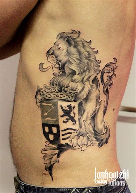 family tattoo black and grey black and grey lion with family crest tattoo on man side rib