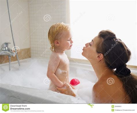 Babies In A Bathtub by Baby While Washing In Bathtub Stock Image