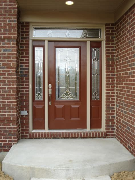 Entry Front Doors For Homes Exterior Wood Entry Door With Frosted Glass Insert And Brick Wall Exterior House Design Ideas