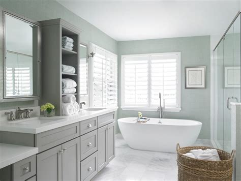 transitional bathroom  white countertop medicine cabinets