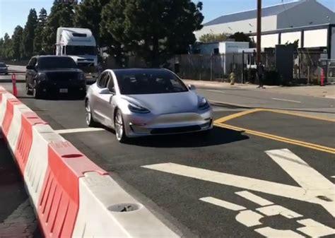 tesla outside tesla model 3 spotted testing along hyperloop track