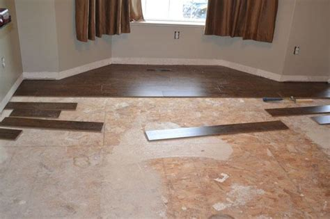 how to install engineered wood floor over tiles