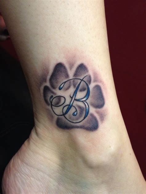 dog paw tattoo on wrist paw print tattoos ideas