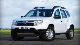 Renault Duster White New Dacia Duster White Driving In Line