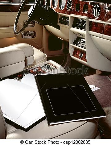 stock photos of luxury car interior with books on seat