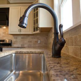 bronze faucet with stainless sink bronze faucets rubbed bronze and stainless sink on