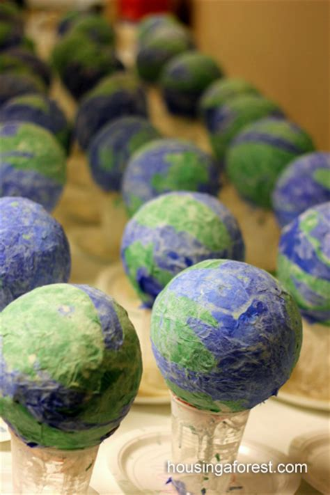 How To Make A Paper Mache Globe - paper mache light up globes housing a forest