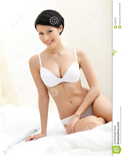naked woman in bed halfnaked woman sits on the bed stock images image 27253014