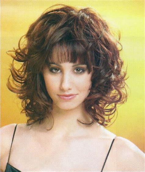 medium hairstyles curly hair with bangs medium layered curly hairstyles