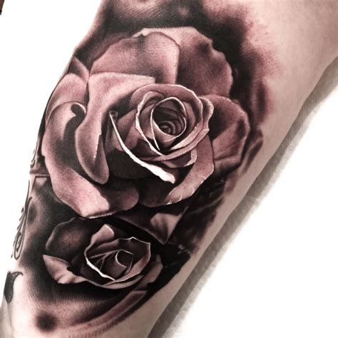 forearm rose tattoo on arm