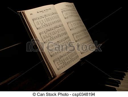 songs with our closed books stock photo of book hymnal open on piano