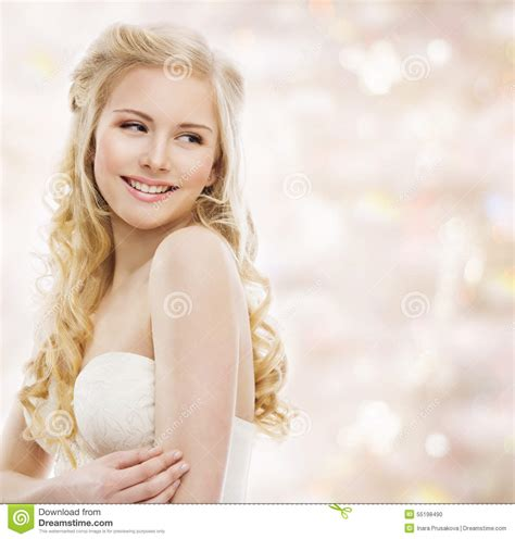 youngest looking women woman blond long hair fashion model portrait smiling