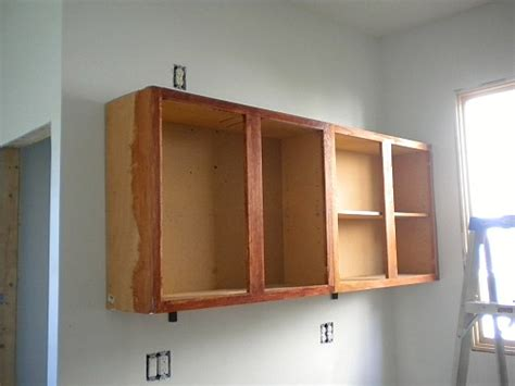 how to hang kitchen wall cabinets how to hang cabinets s big idea