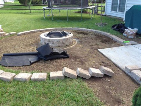 rumblestone pit laying the rumble border for pit backyard patio redesign project