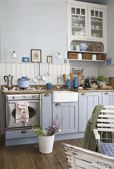 english country style white kitchen with modern wood base top 4 kitchen styles london local services