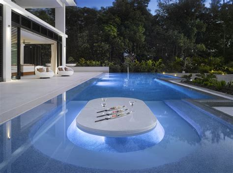 table for inside swimming pool inside justin bieber s side barbados home
