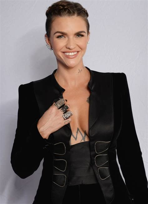 Ema Blouse 3 Ruby ruby looks fierce as she flashes cleavage in plunging suit as she prepares to host mtv ema