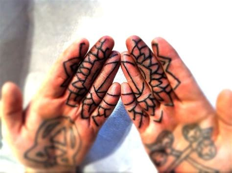 finger tattoo swelling thomas hooper occult vibrations