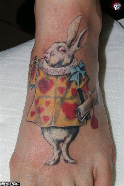 an alice in wonderland tattoo of the white rabbit