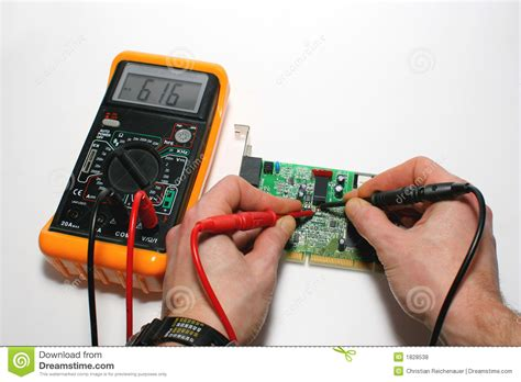 how to use a digital multimeter to test a resistor testing a computer modem with digital multimeter royalty free stock photos image 1828538